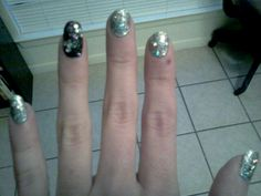 Silver with mini and large holo pieces. Accent finger is black with custom color and rhinestone overlay.