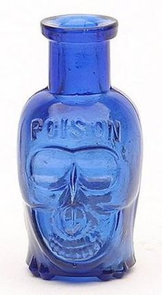A poison figural skull bottle, America, 1890 to 1900. Cobalt blue, tooled square collared mouth and smooth base.