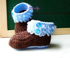 Brown and blue crochet booties for your baby boy or a gift to a special little one.