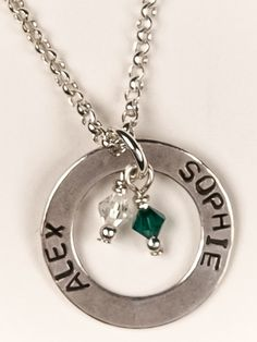 This 1 sterling silver circle is able to be personalized with up to three names and birthstones.
