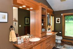 Dual sinks in a built-in vanity in master bathroom.