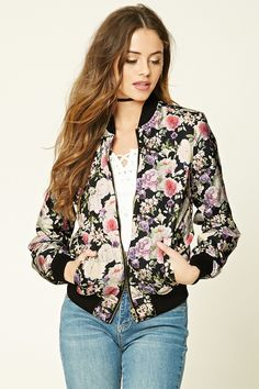 A woven bomber jacket featuring an allover floral print, zip-up front, contrast ribbed trim, two front snap-button pockets, and long sleeves.