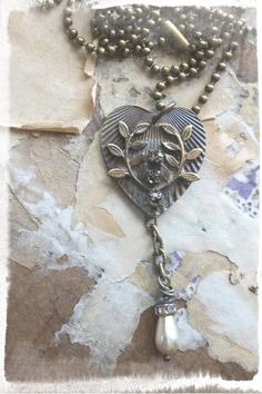 Vintage brass ridged heart with branches and rhinestones soldered on top and a chain pearl drop