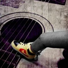 Some way to plucking the strings, sneaker on my finger...