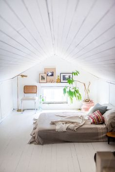 White Attic Bedroom #attic #whitewalls #greybedspread