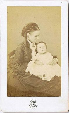 I love that we see a sense of happiness on the face of this beautiful young Victorian mother as she loving gazes down at her child.