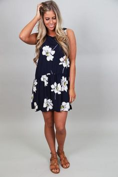 "Navy in color. Floral printed. Open back, sleeveless dress. High neck line. Dress is lined! Model is a 2/3, wearing a small. She is also 5'6"" tall.   Small 0-2/"