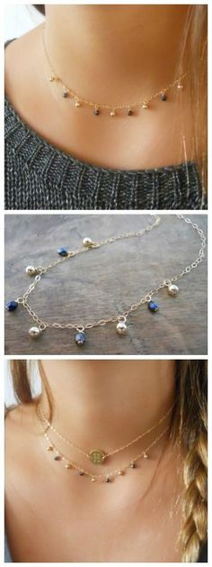 Dainty gold charms necklace with gold and dark blue beads.
