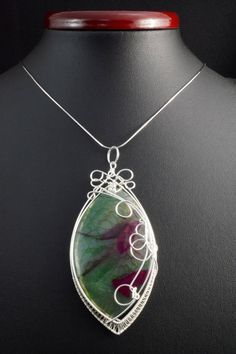 A unique, handmade, wire wrapped pendant with Dragon Veins Agate.  Pendant was made by Me, using an extremely labor-intensive and precise wire-wrapping technique, with copper wire. Dimensions of pendant:  length: 9.3 cm (3.66 inch) width: 4,2 cm (1.65 inch)  You receive this unique pendant in jewelry box, so it is ready to be a gift.  --------On this auction you buy pendant without chain.---------   Refunds and Exchanges:  If you are not satisfied with your purchase for any reason, please…