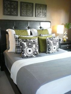 We have this head board & multi-gray comforter. Trying to add another color when we move.... green? Maybe. Needs to be masculine for him but not so drab for me.