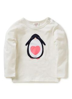 100% Cotton Tee. Long sleeve, crew neck tee. Self bound neckline, with snaps on left shoulder-line. Features applique penguin on front. Available in Canvas, as shown.