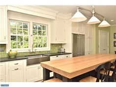 The green backsplash and wall covering brings the greenery from outside in!