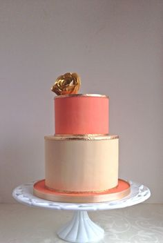 Coral Cake with gold accents and flower
