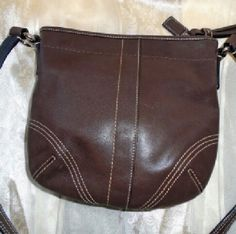 Vintage Coach Brown Leather tote Crossbody bag. Vintage 1960s Coach crossbody tote bag.  Has 1 zipper pocket in interior. Tread detail on body. Fringe charm on bag with COACH chain tag. Dark brown interior. Strap is adjustable but not removable. Has some scuffs and light marks from age. Still in overall good condition. Coach Bags Crossbody Bags