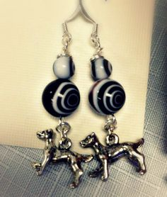 For the DOG LOVERS! Dog Charm Black and White Spiral Lollipop Earrings by SparkleCatStudio, $12.00  25% of proceeds donated to animal rescues: The Humane Society of Alamance County OR The Biscuit Foundation. We are volunteers and foster 6 cats of our own! Find us on Facebook!