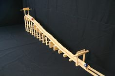 Create contraptions like coasters, mazes, and Rube Goldberg machines!