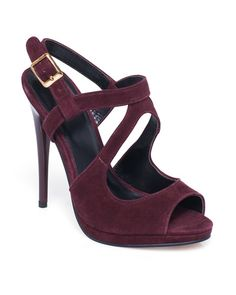 Curved cutout straps and a stiletto heel create a sexy, sculptural silhouette on this suede peep toe style