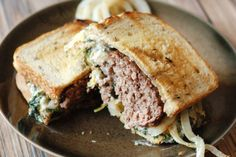 This spinach artichoke patty melt combines all the flavors you love about your favorite restaurant dip into a creamy sandwich topping. It makes the perfect topping for a patty melt!