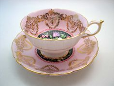 Pink Paragon Tea cup And Saucer Bouquet of flowers on black, Gold filligree on pink teacup and saucer