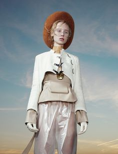 this is your world shape it or someone else will | Dress J.W. Anderson. Jacket and hat The Costume Studio.