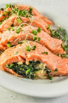 Spinach Feta Stuffed Salmon Spinach Feta Stuffed Salmon a delicious weeknight meal thats ready in 20 minutes Healthy Salmon Recipes, Fish Recipes, Seafood Recipes, Vegetarian Recipes, Dinner Recipes, Cooking Recipes, Salmon Spinach Recipes, Healthy Foods, Keto Recipes