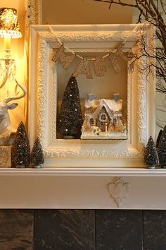 "Christmas vignette displayed in a shadow box with a painted frame around the opening - The vignette extends beyond the frame onto the mantel. Also notice the ""Magic"" garland at the top of the frame."
