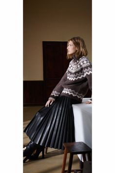 I like the hard and soft texture combo of a cozy fair isle sweater  paired with a leather knife-pleated skirt.