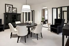 international style par excellence, black & white proposed in an extremely refined dining room interior design, lighted by touches of chrome and deco elements Black And White Dining Room, White Rooms, Black White, White Style, Dining Room Colors, Dining Room Design, Dining Rooms, Lounge Design, Silver Living Room