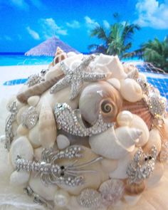 Brooch Bouquet, Beach Wedding Bouquet, Shell Bouquet, Keepsake Bouquet via Etsy. Now, how clever is this? Seashell Bouquet, Beaded Bouquet, Crystal Bouquet, Boquet, Diy Bouquet, Brooch Bouquets, Tropical Wedding Bouquets, Beach Wedding Flowers, Wedding Beach