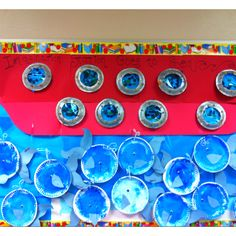Summer bulletin board from preschool art: Wednesday's whales and Fridays fish . ( we did manatees on Monday).