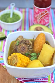 Sancocho de Cola (Oxtail Colombian Soup) pounds oxtails (cola de res) cup of aliños sauce 3 ears fresh corn 12 cups of water Salt and pepper, to taste 2 green plantains 6 medium white potatoes 1 pound yuca cup chopped fresh cilantro~~~~ Colombian Dishes, My Colombian Recipes, Colombian Cuisine, Mexican Food Recipes, Colombian Sancocho Recipe, Spanish Recipes, Jamaican Recipes, Spanish Food, Oxtail Recipes