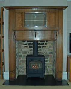 Original 1920's mantel with mirror, slate tiled hearth, reclaimed brick slip to sides of chamber to match original back and Gazco gas stove,...