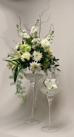 This elegant all white arrangement sparkles in over-sized wine goblets. Our Floral Department specializes in custom flowers! Wine Goblets, All White, Sparkles, Special Occasion, Wedding Flowers, Birthdays, Valentines, Table Decorations, Elegant