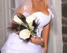 LPV Wedding: Jonathan and Tiffany #peacock #bouquet