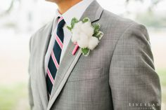 This cotton boutonniere is oozing sweet southern charm!  #boutonniere #groom #groomdetails #weddingdetails #southernweddingdetails #charlestonwedding