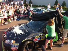 Dale Earnhardt Jr. unveils the Dark Knight Rises paint scheme on the No.88 car which was chosen by fans. (May 25, 2012)