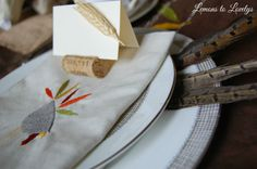 Thanksgiving table place setting.  Crate & Barrel linens, Vera Wang China, Pheasant Feathers, DIY wine cork place card holders.  Tap picture to read more on the blog...