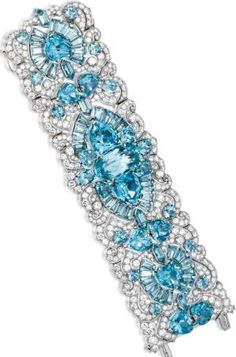 Platinum, Aquamarine and Diamond Bracelet, Circa 1935. The wide openwork strap of scroll and geometric design set with heart-shaped, oval, tapered baguette, round and bullet-shaped aquamarines weighing approximately 145.00 carats, within a ground of round and single-cut diamonds weighing approximately 50.00 carats, length 7 inches, possibly Paul Flato. Sotheby's. by shawna