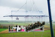 getting married up the sky...and then they bungee jump their way off...not kidding