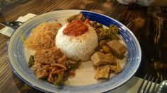 """ Nasi sayur ""  A various type of side dishes eaten with rice"