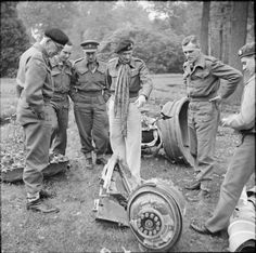 Field Marshal Montgomery examines the remains of a German V2 rocket near the HQ of Major General Percy Hobart, GOC 79th Armoured Division (left), 30 October 1944.