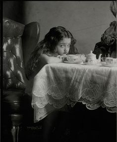 Vladimir Clavijo Telepnev  Russian photographer Vladimir Clavijo Telepnev's mind seems stuck in the past. His work is a masterful blend of drama, romance and adequate measures of quirkiness, all in sepia tones like something straight out of the turn of the past century.