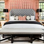 bedrooms - coral chevron herringbone pattern drapes gray tufted wingback bed coral chevron pillow black wood bench gray linen silver nailhead trim alabaster lamps