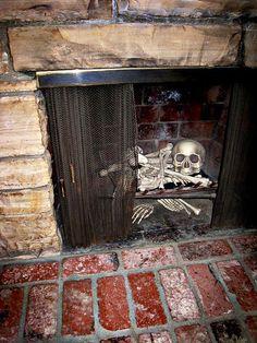 ☠ ℋalloween • Let your fireplace join in the party by setting a broken up skeleton in it and leave some cold ashes under and around