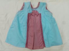 Beautiful pink and blue dress completed with a bow!