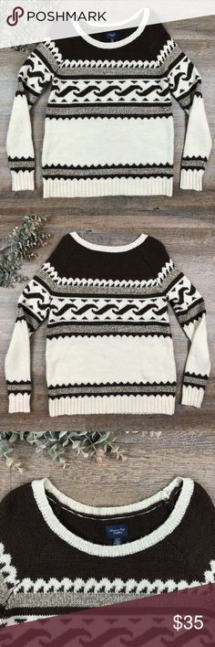 American Eagle Sweater Cute and cozy brown and white patterned American Eagle Sweater! In good condition. 46% acrylic, 28% polyester, 26% wool. Size XS. D-11 American Eagle Outfitters Sweaters