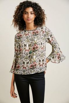 Fluted sleeves are a THING this season and we absolutely love it! This top is seriously dreamy