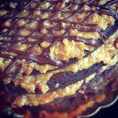 Our German Chocolate cake has gone nude and is looking more delicious than ever! #blushing #nudecake #torte #cake #germanchocolate #delicious #coconut #pecans #chocolate
