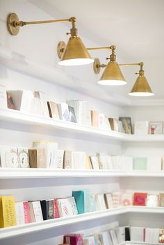 Open Door Policy - Sugar Paper Stationer's Brentwood Flagship - Lonny featuring the Boston Functional Library Wall Lights by E. Library Lighting, Bookcase Lighting, Kitchen Lighting, Home Lighting, Lighting Design, Picture Lighting, Lighting Stores, Task Lighting, Kids Lighting