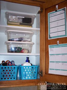 """i think creating a """"command center"""" in a cabinet is a great option for keeping things out of the way. HOWEVER, I'd have to do some serious purging to make this happen."""